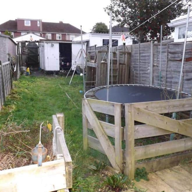 garden with fence and trampoline
