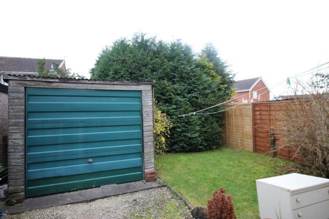 garage with green garden