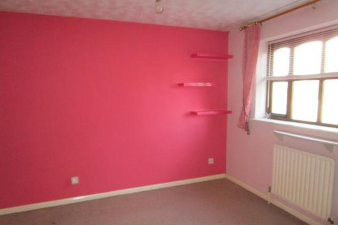 room with a pink wall