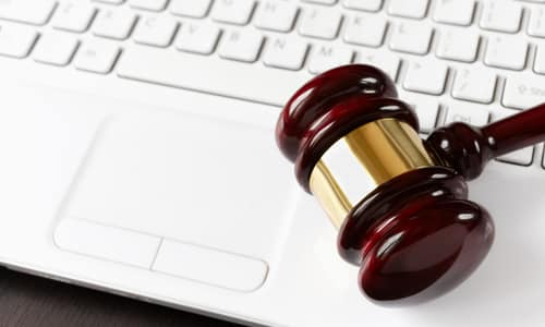 gavel and white laptop