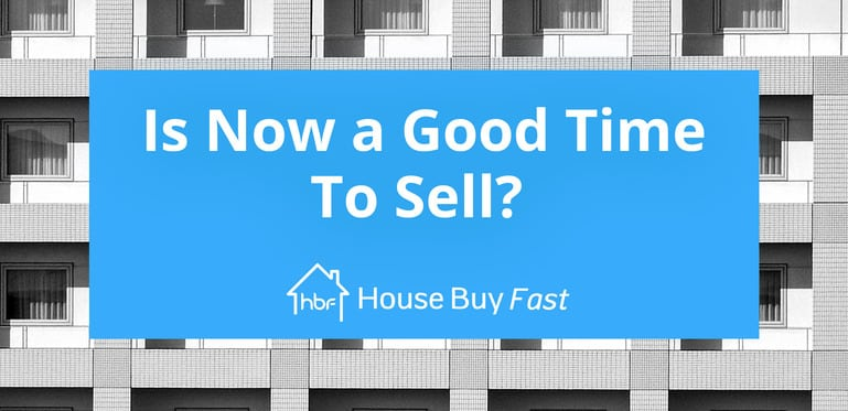 is now a good time to sell with buildings in background