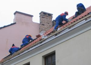 Roofers on a roof
