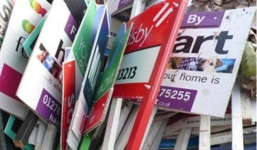 For sale signs from estate agents
